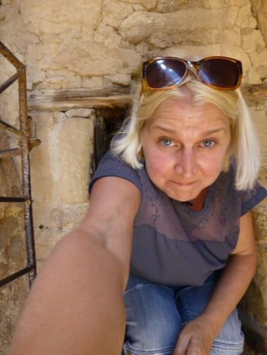H crawling through entrance  to ruins, selfie