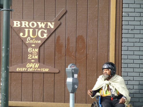 A patron of the Brown Jug catching some rays open a 6 am