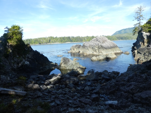 Hot Springs Cove with hot spring pools hidden in the rocky shore.